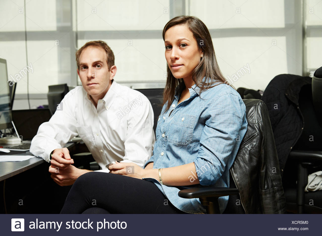 Portrait of colleagues in office - Stock Image