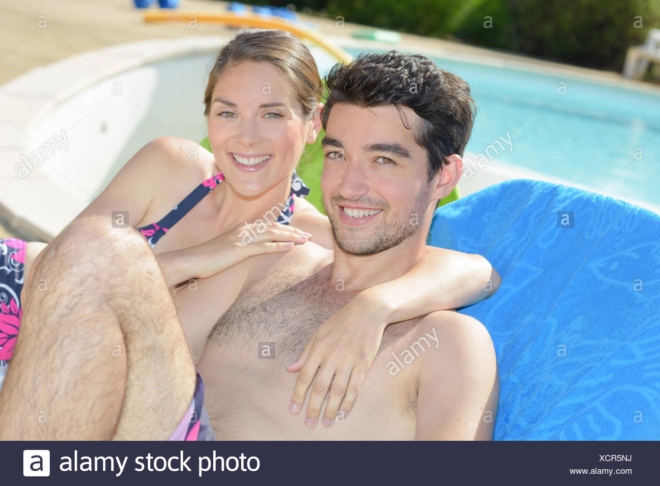 having a picture beside a swimming pool - Stock Image