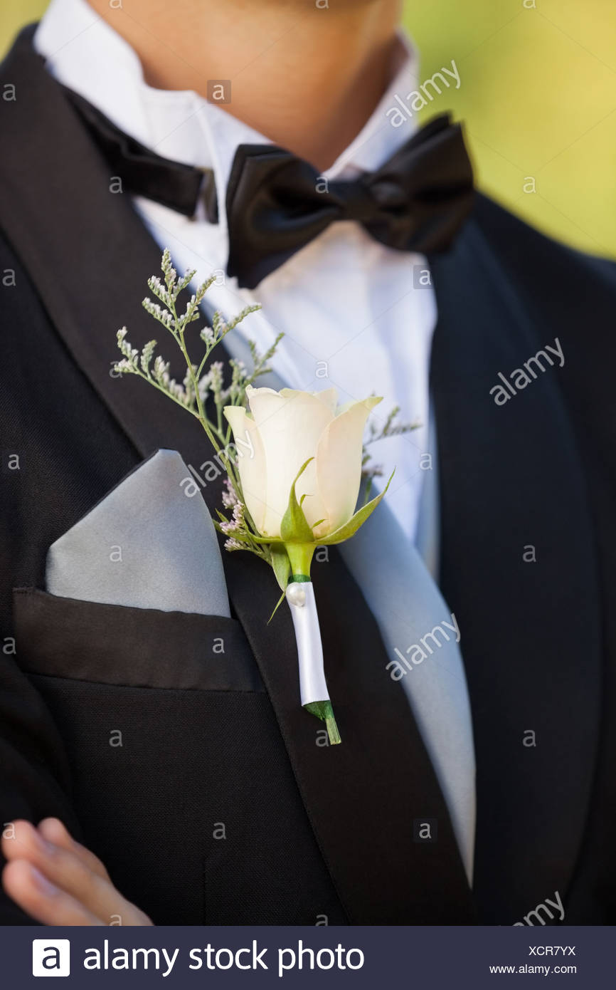 Mid section of flowers on lapel of male Stock Photo