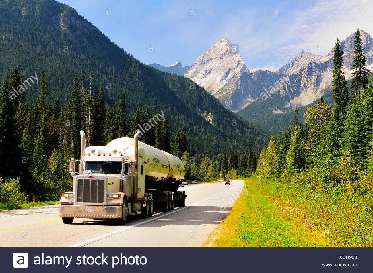 A Gibsons truck hauls propane along the Trans Canada Highway in Glacier National Park - Stock Image
