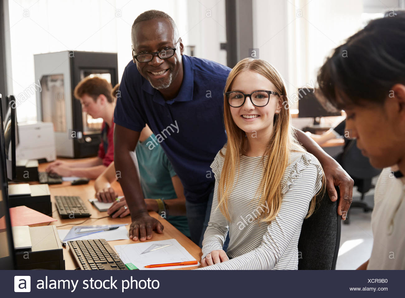 Portrait Of Design Student With Teacher Studying CAD/3D Printing - Stock Image