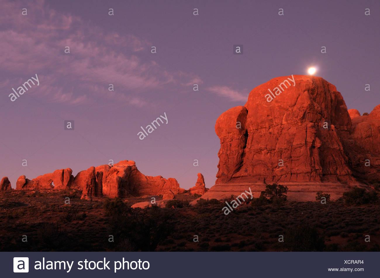 Moonrise dusk Window section rock formations Nature Landscape Arches National Park National Park near Moab Utah USA America - Stock Image