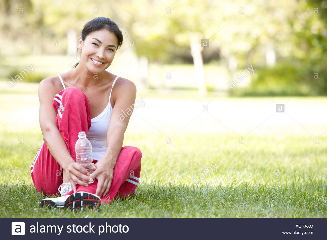 Young Woman Resting After Exercise Stock Photo