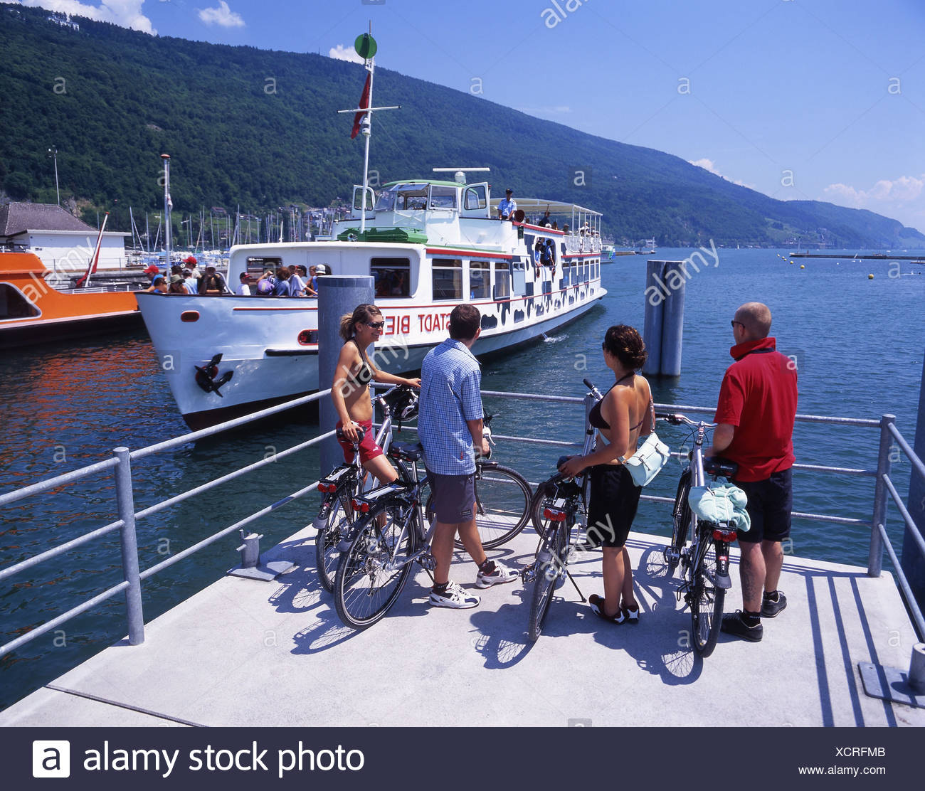 Canton Bern bicycle Biel Bielersee Lake Biel bike canton excursion group lake lakes passengers scenery - Stock Image