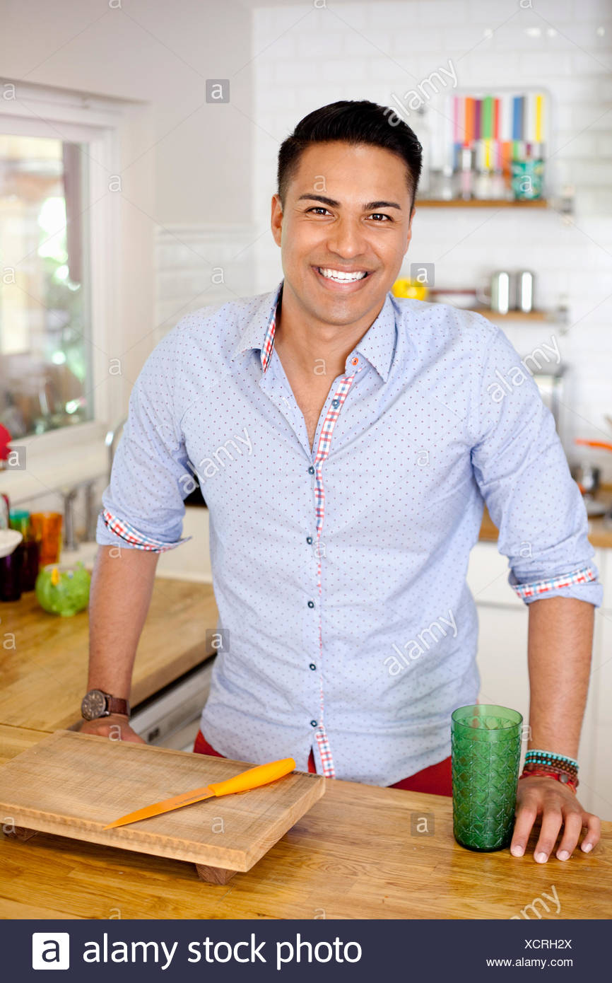 Mid adult man in kitchen, portrait - Stock Image