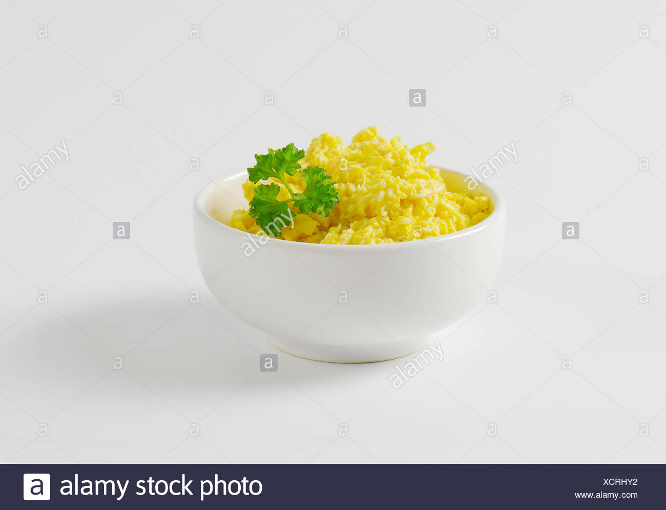 Bowl of scrambled eggs - Stock Image