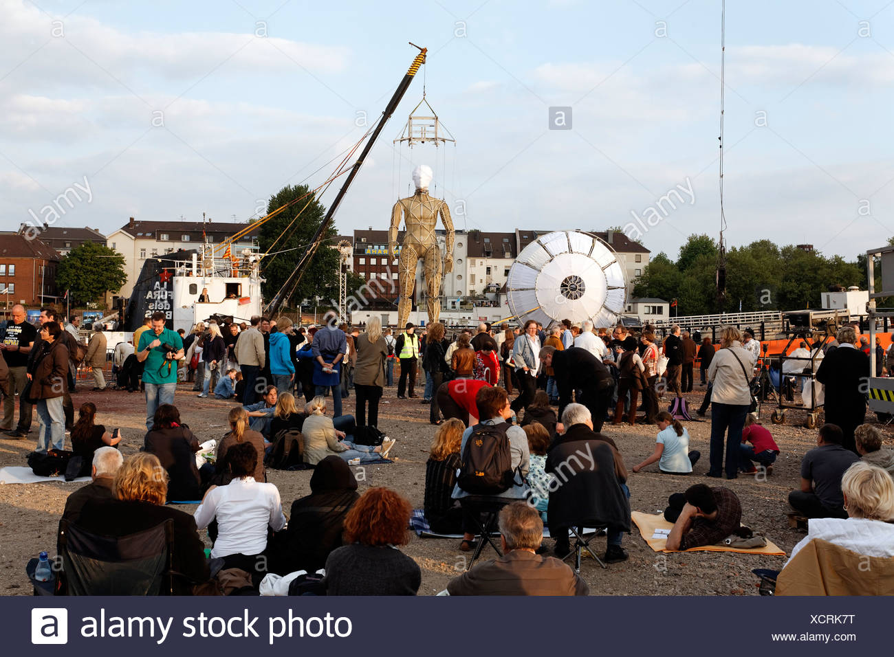 Spectators on the Mercatorinsel island waiting for Global Rheingold, open-air theater by La Fura dels Baus, Duisburg-Ruhrort - Stock Image
