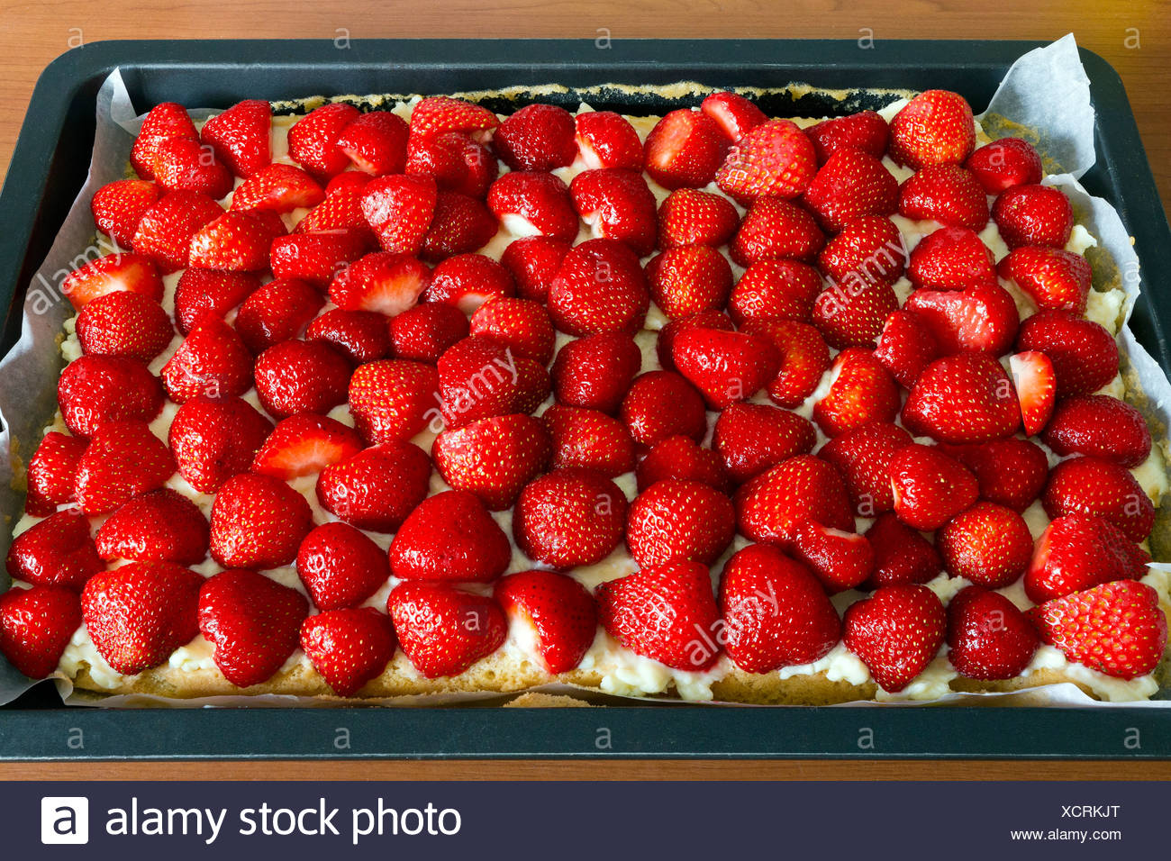 A strawberry cake on a baking sheet - Stock Image