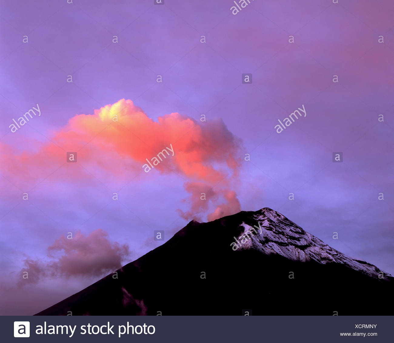Orange-Tinted Steam Vents From the Caldera of Tungurahua Volcano After a Recent Eruption - Stock Image