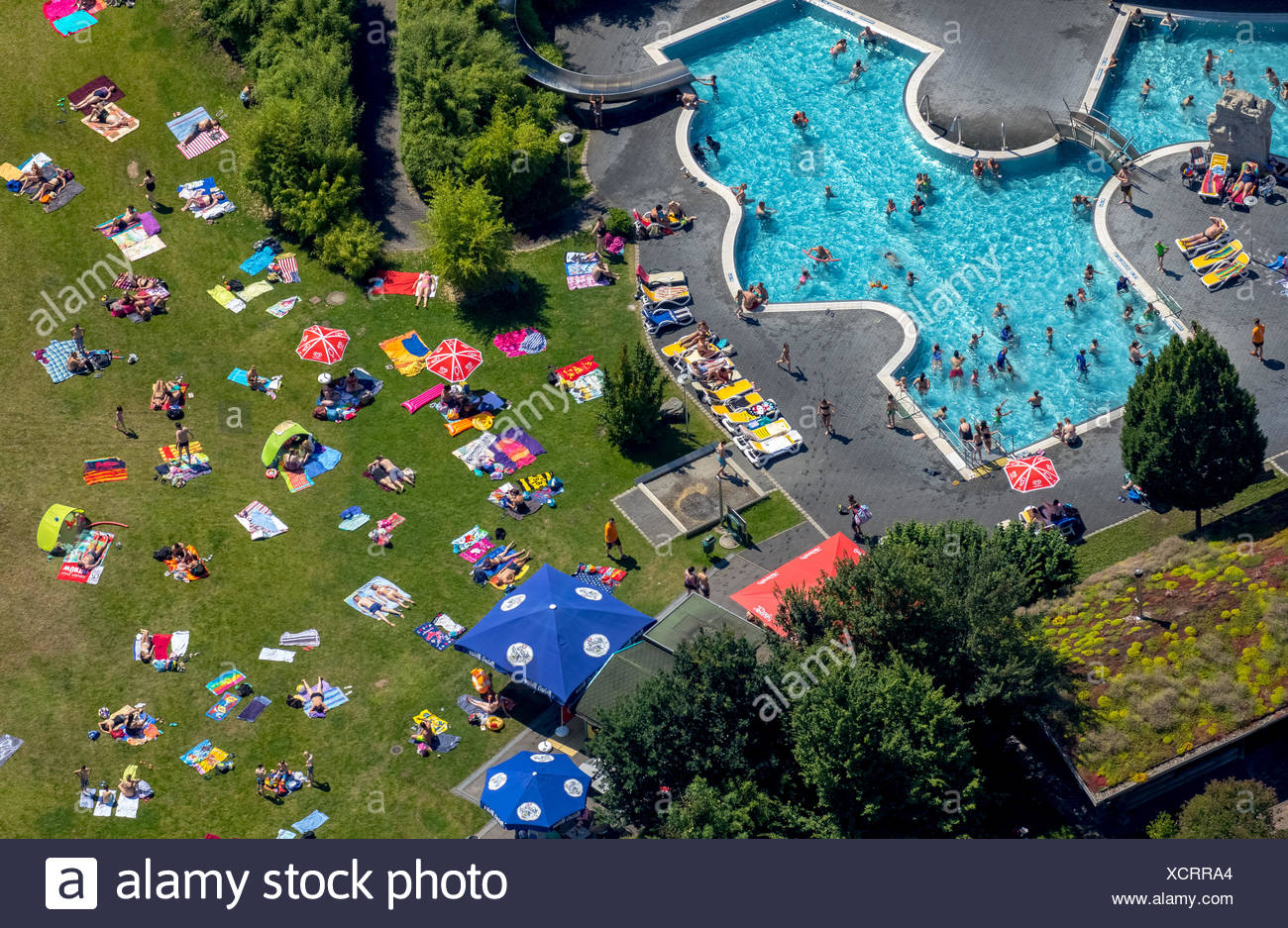 Aerial view, bathers at Atlantis outdoor pool, sunbathing lawn, Dorsten, Ruhr district, North Rhine-Westphalia, Germany - Stock Image