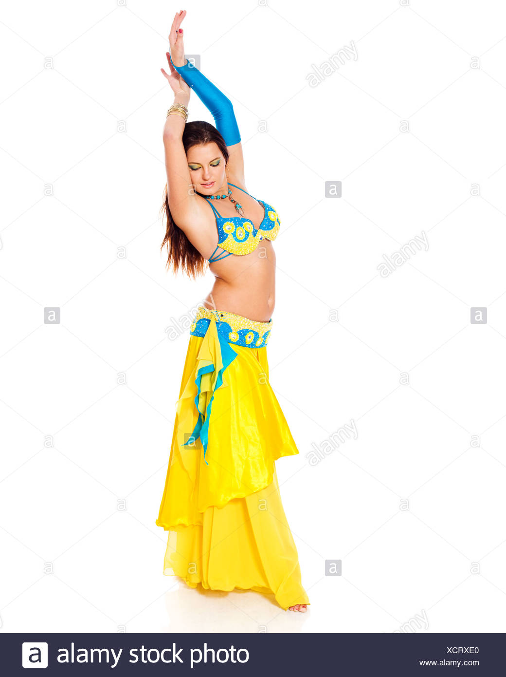 cb50319238b21 Beautiful young brunette belly dance woman isolated on white - Stock Image