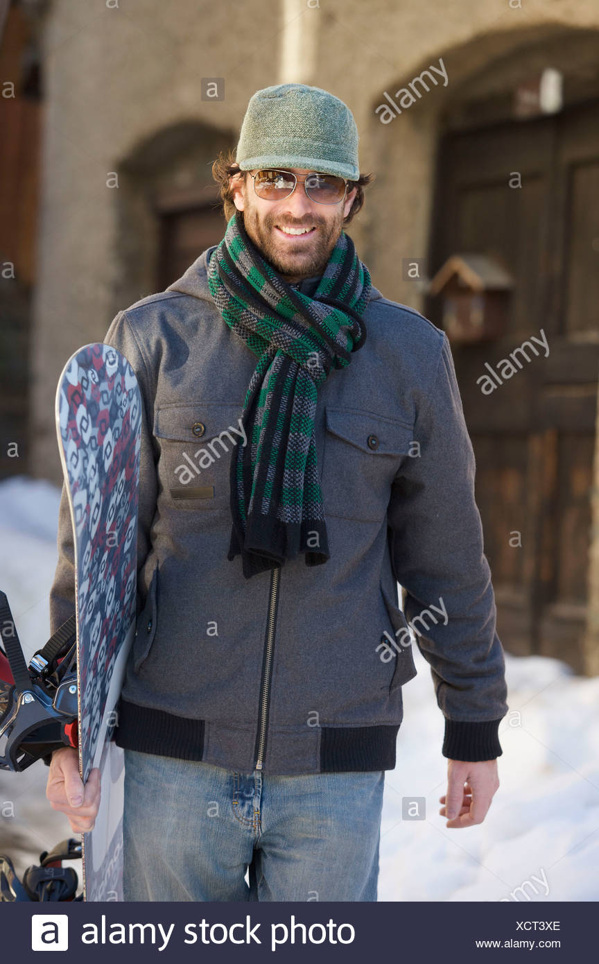 Snowboarder in casual wear. - Stock Image