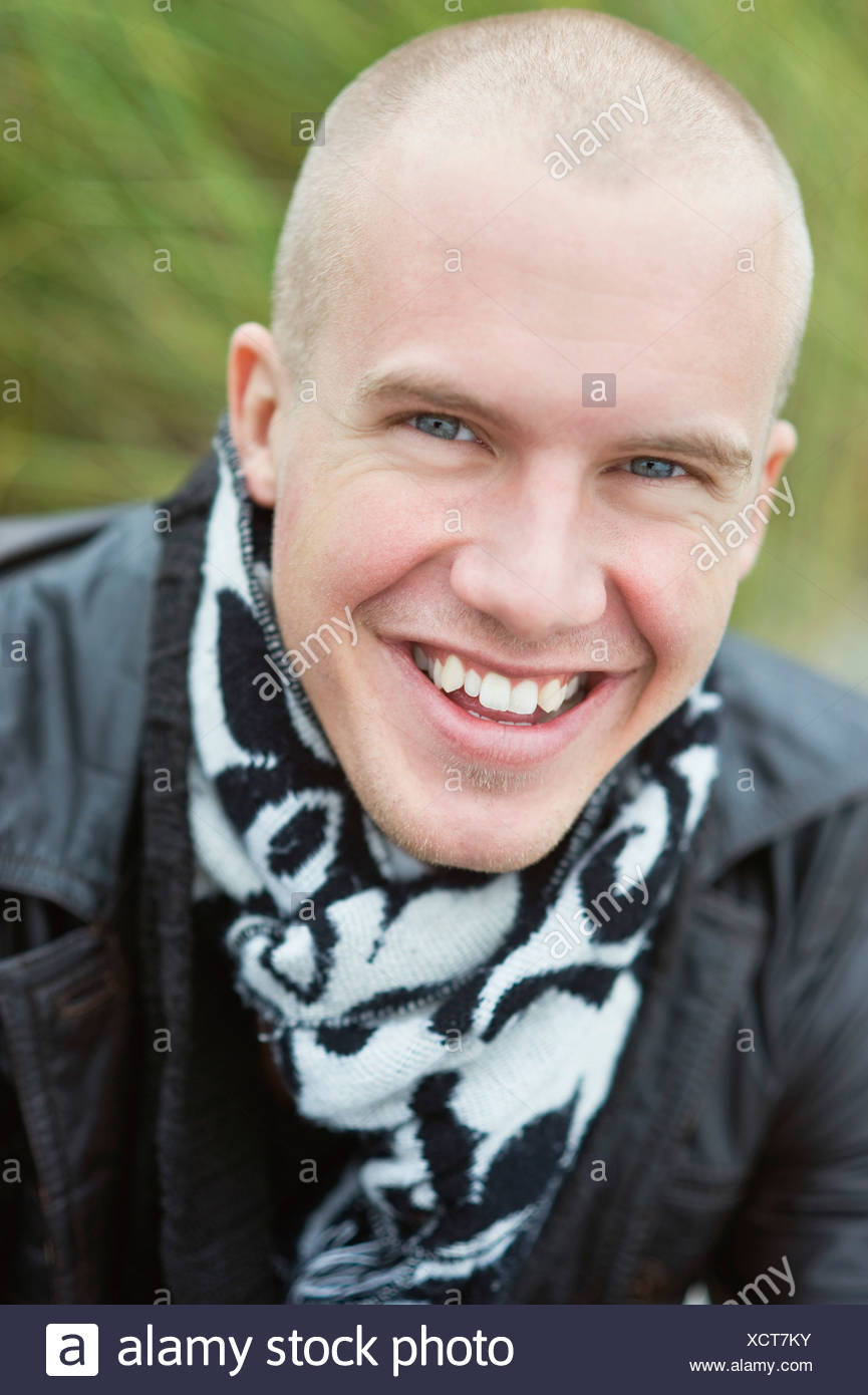 Man with shaved head looking at camera Stock Photo