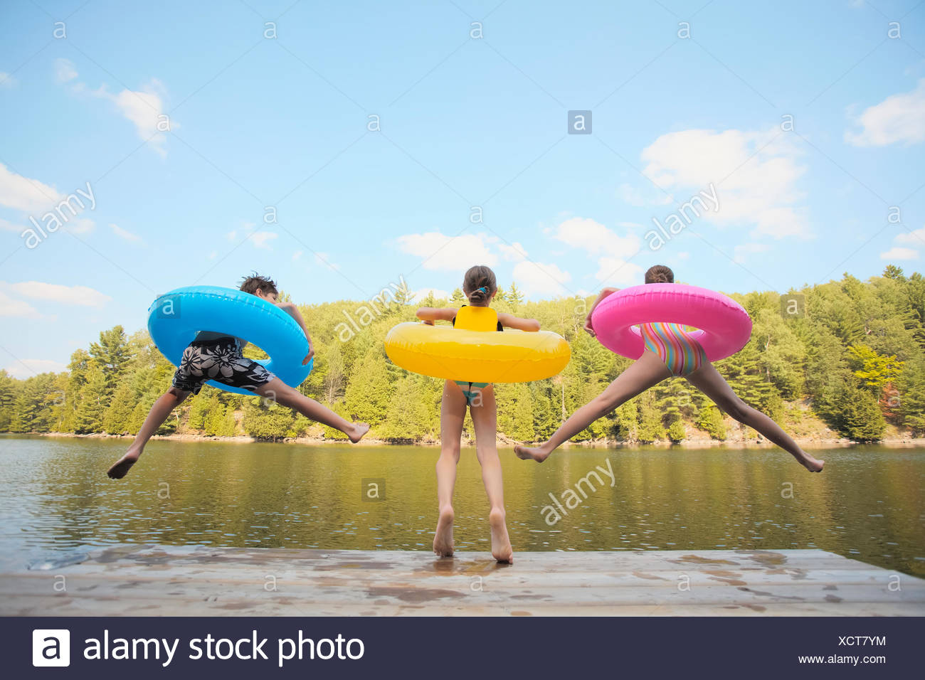 Inflatable,Lake,Jetty,Rubber Ring,Girl,Boy - Stock Image