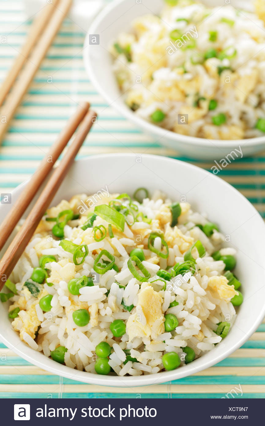 Fried egg rice in a bowl and chopsticks - Stock Image