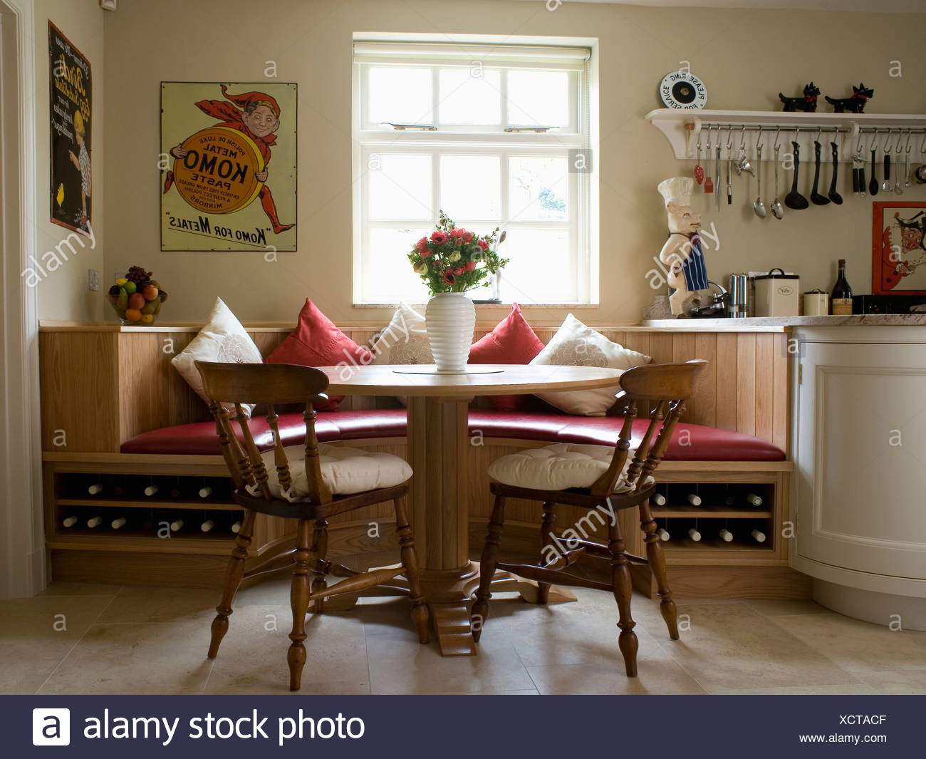 Circular table and wooden chairs in kitchen dining room with ...