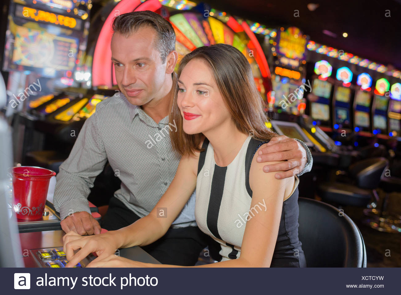 couple playing in casino Stock Photo - Alamy