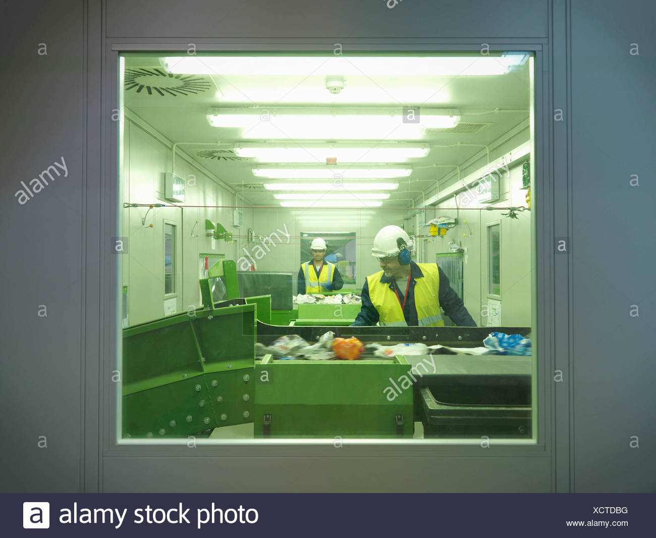 Workers Separating Waste In Plant - Stock Image