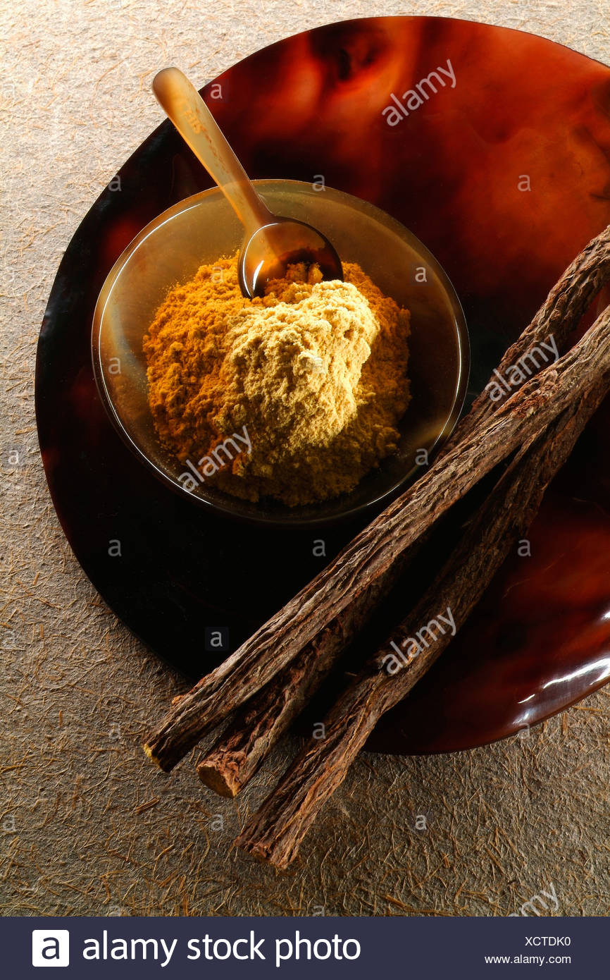 Licorice sticks and ground licorice - Stock Image