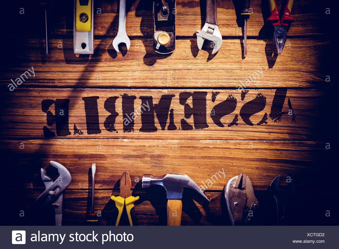 Assemble against desk with tools - Stock Image