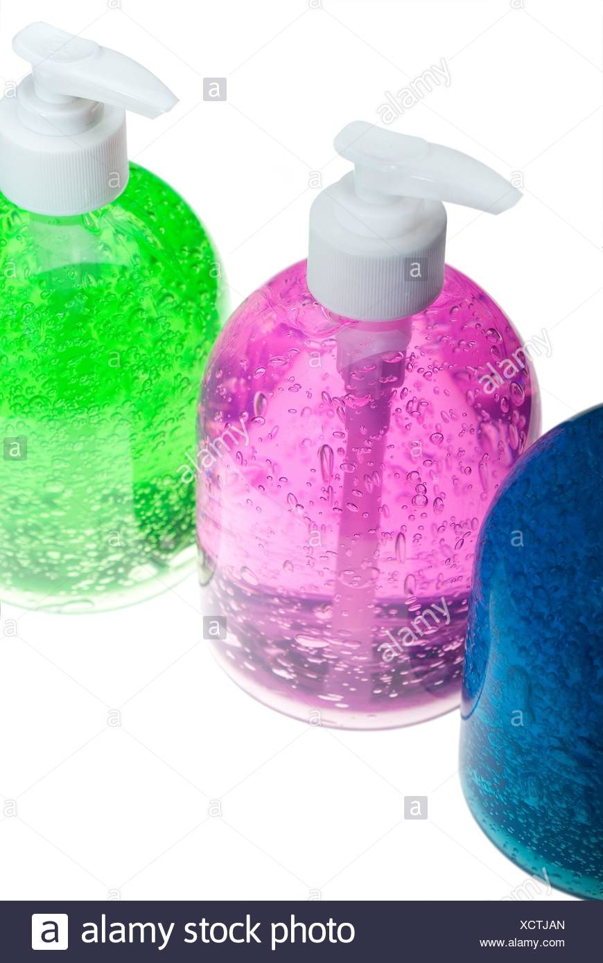colorfull blue,pink and green hair gel bottles over white background. - Stock Image