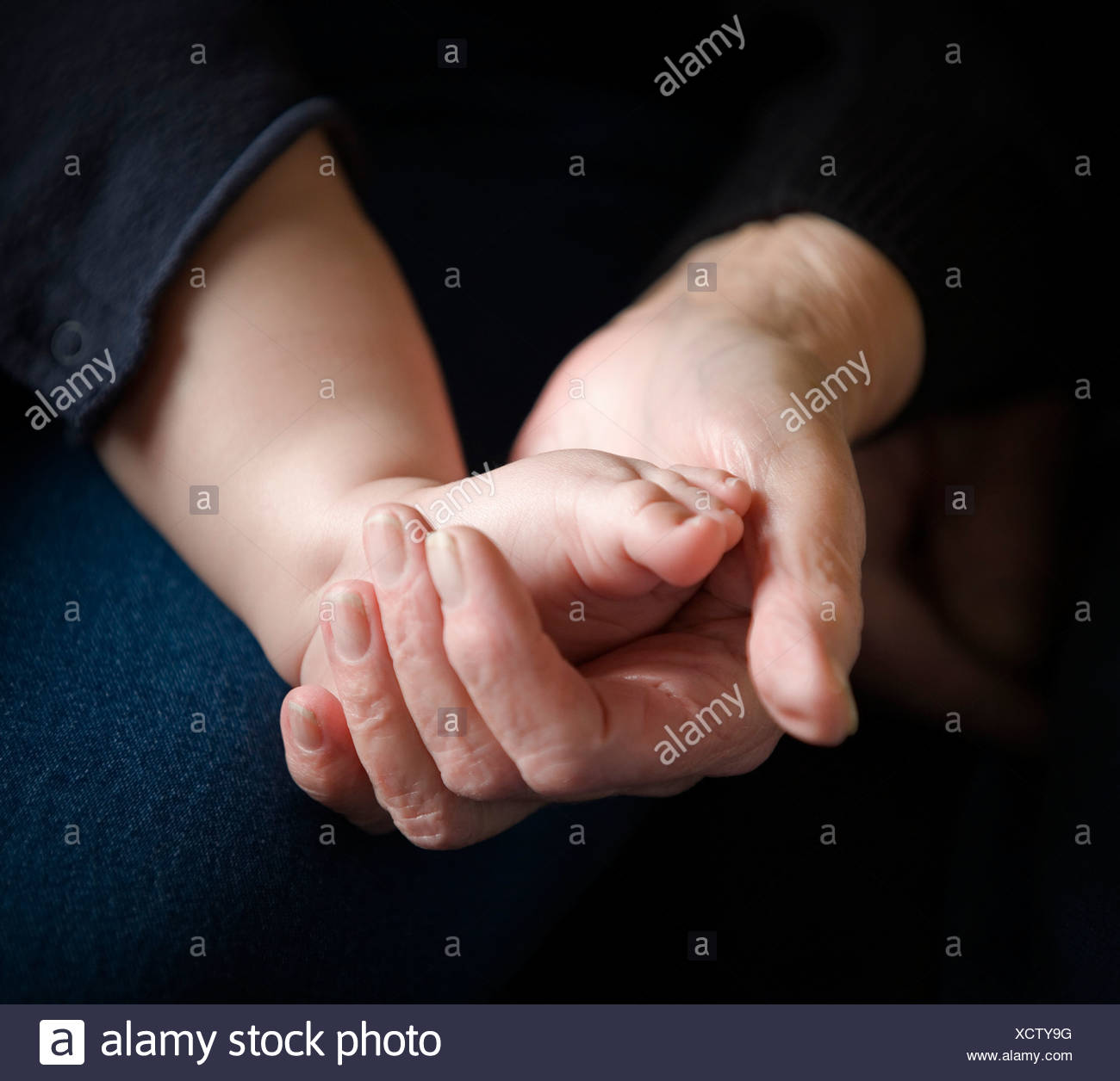 Grandparent with child - Stock Image