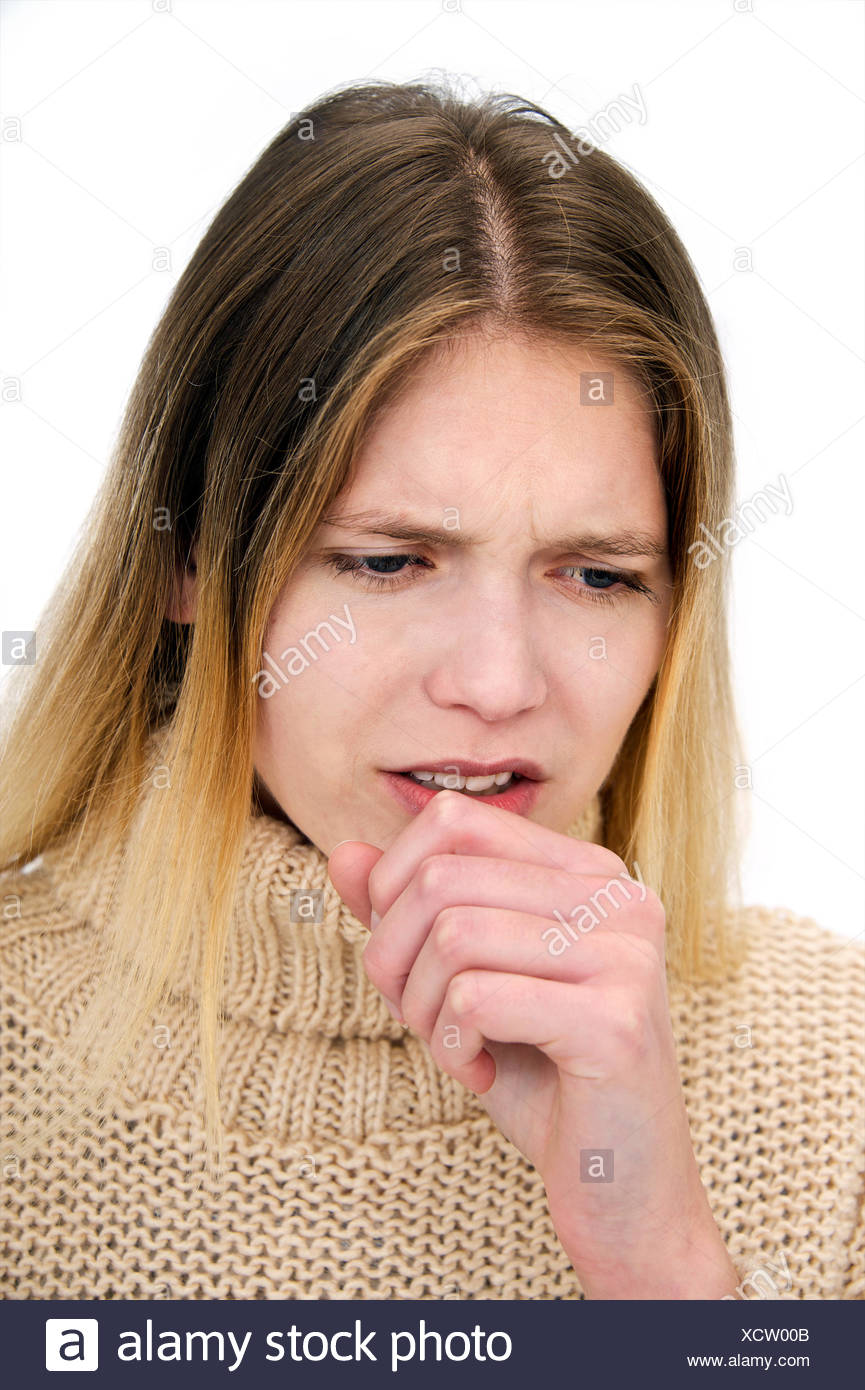 MODEL RELEASED. Young woman coughing. - Stock Image