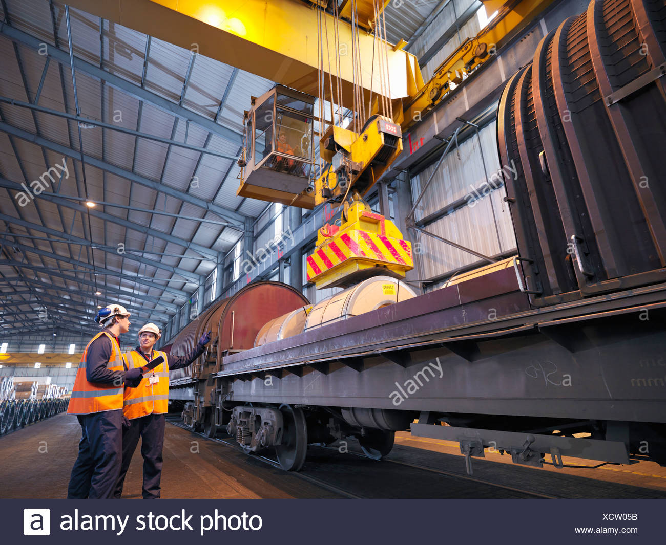 Port Workers Loading Cargo On To Train - Stock Image