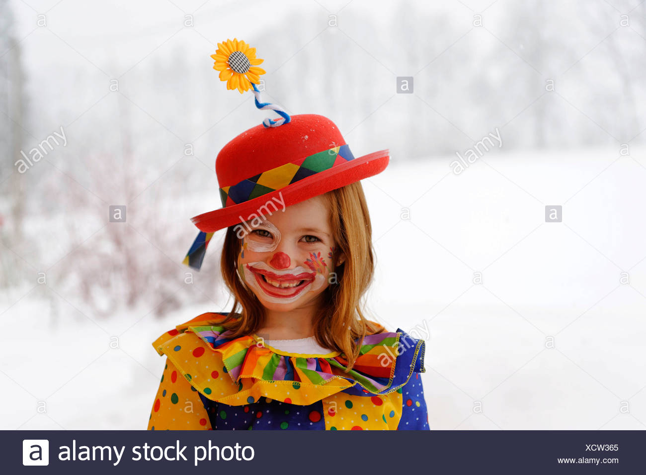 Clown girl in carnival costume - Stock Image