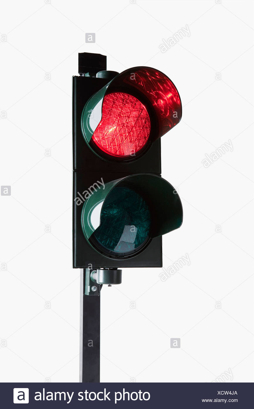 A stoplight with the red light illuminated - Stock Image