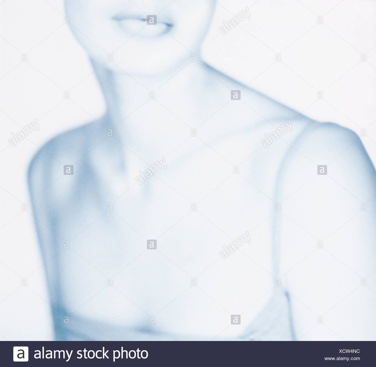 Ghosted image of a woman's neck and chest - Stock Image