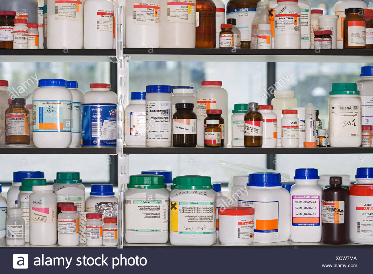 Chemicals on a shelf - Stock Image