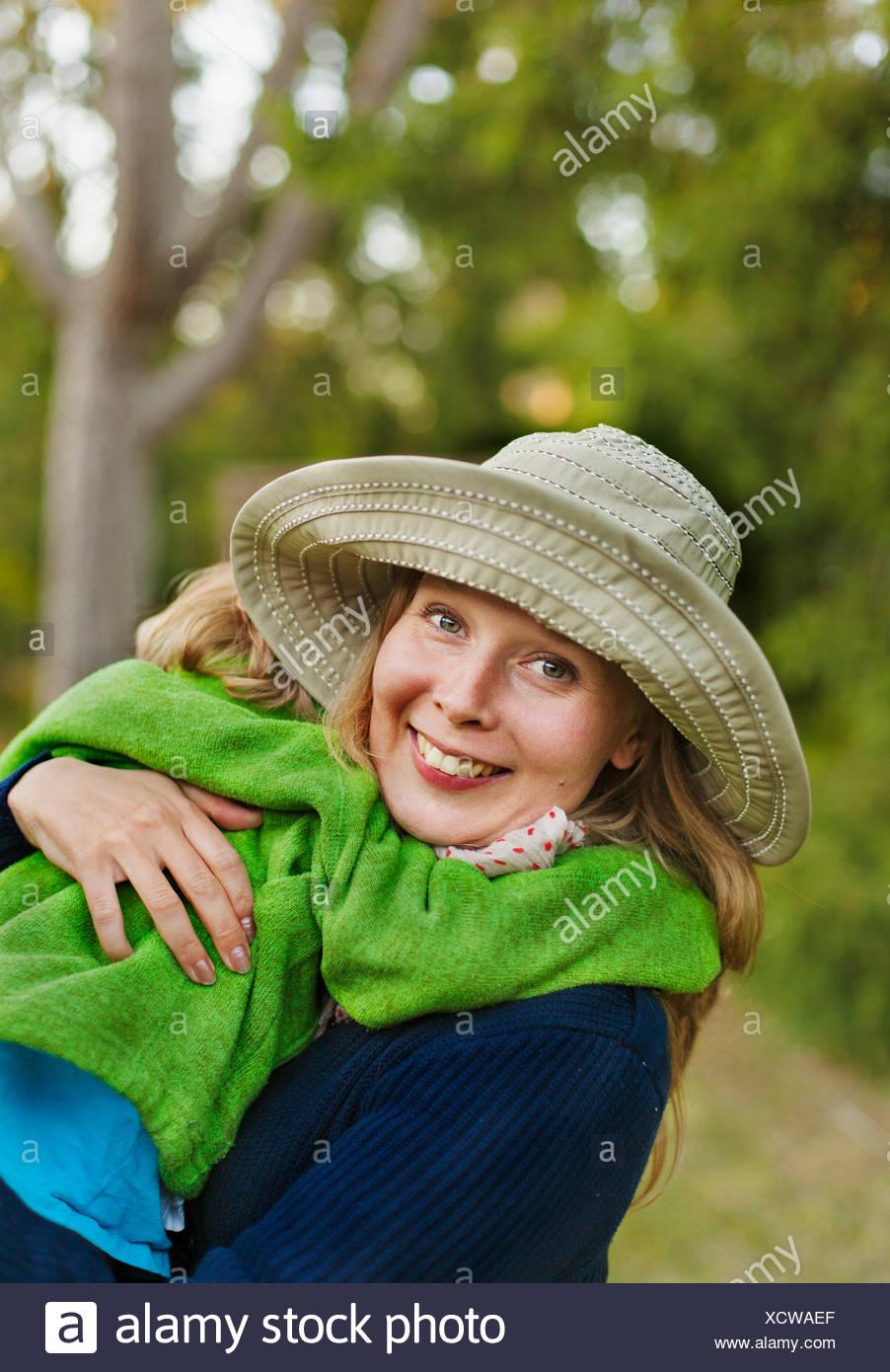 Sweden, Gotland, Gnisvard, Portrait of mother holding son (2-3) - Stock Image