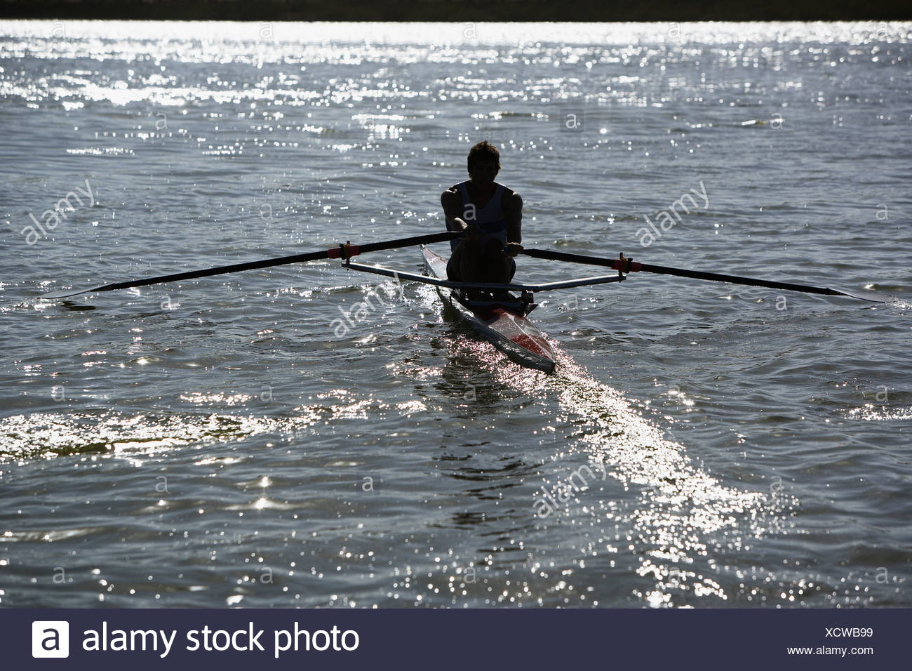 Athlete on a small row boat - Stock Image