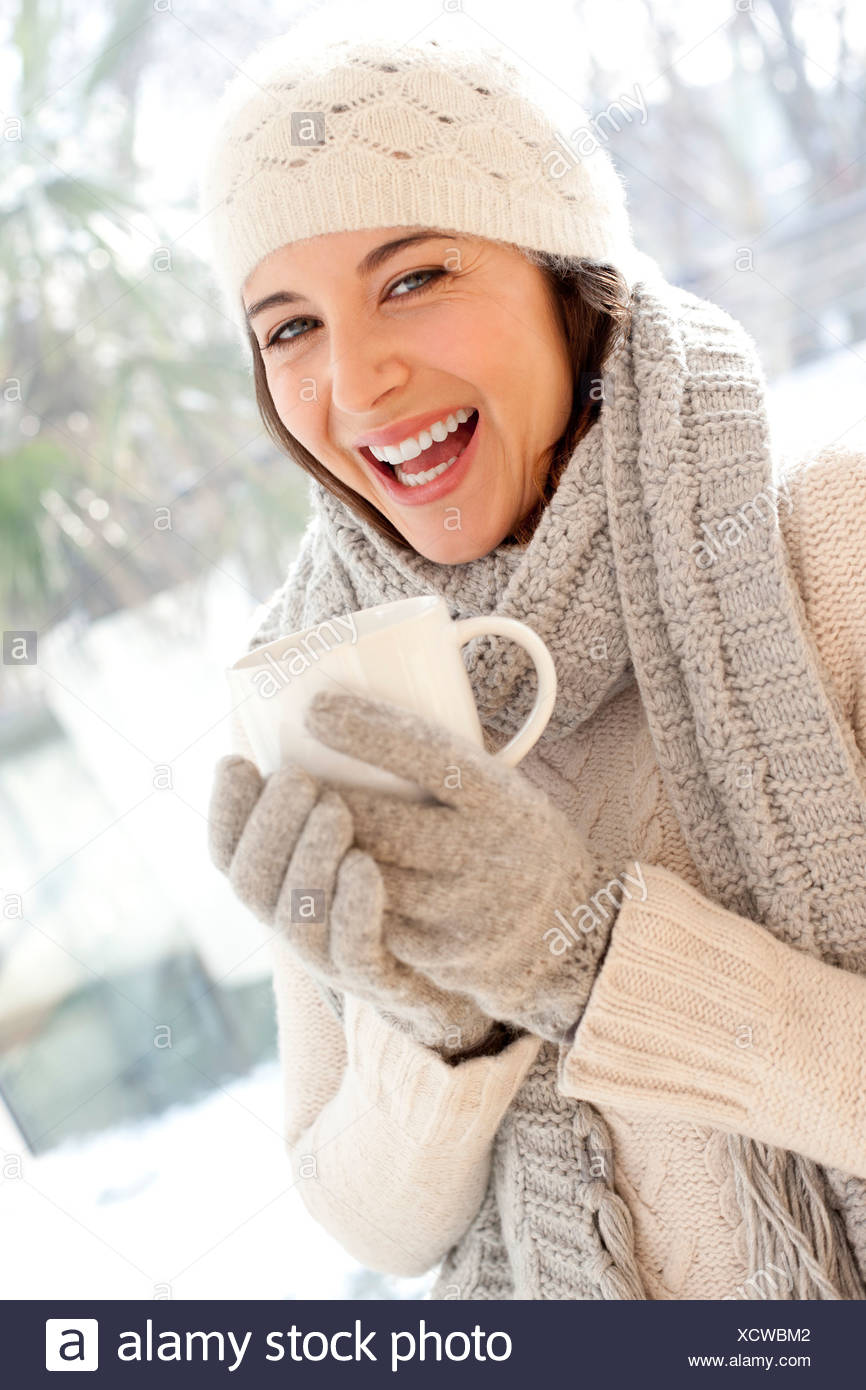 Happy woman in cold weather - Stock Image