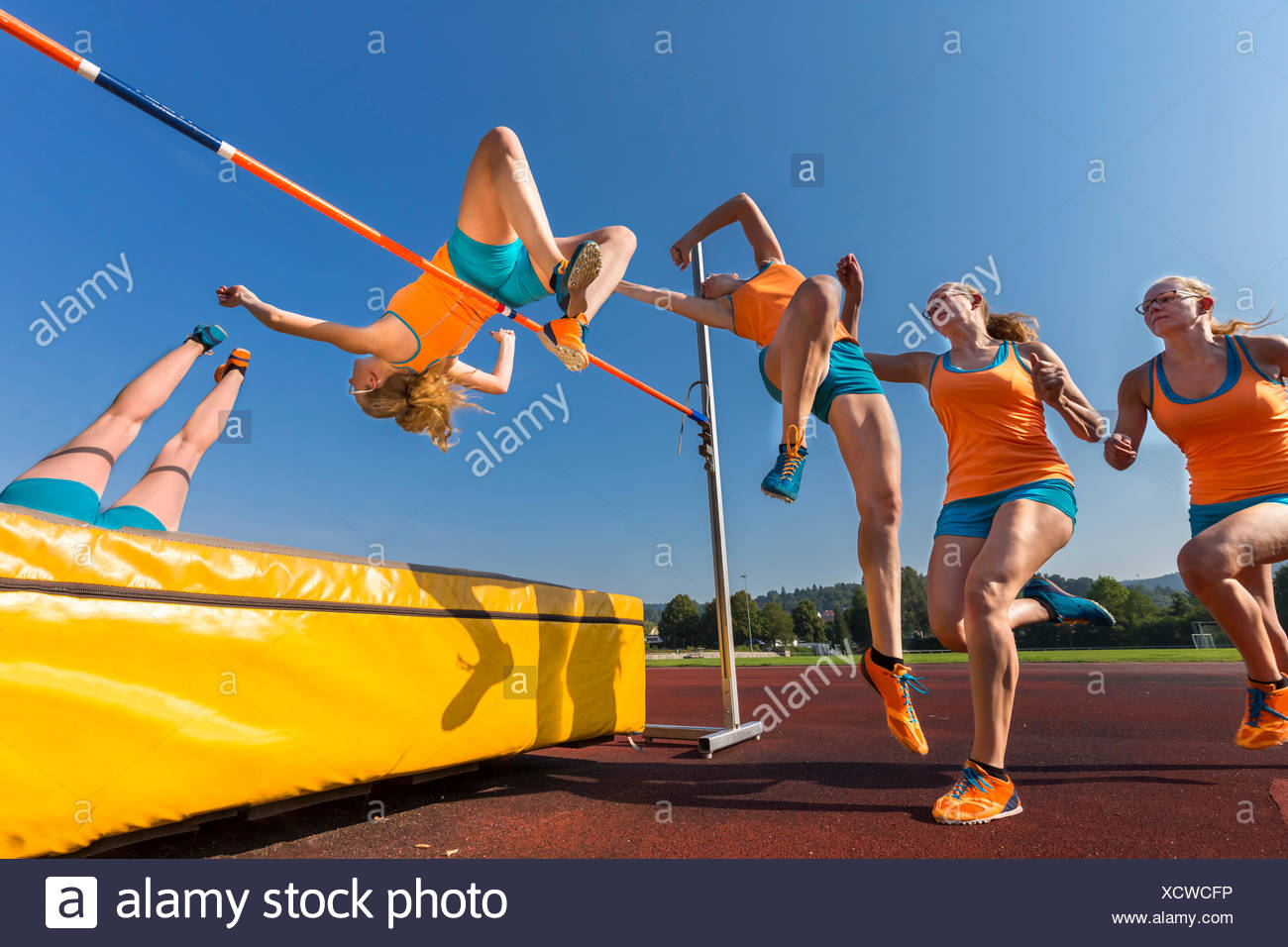 Sequence of high jumper crossing bar - Stock Image