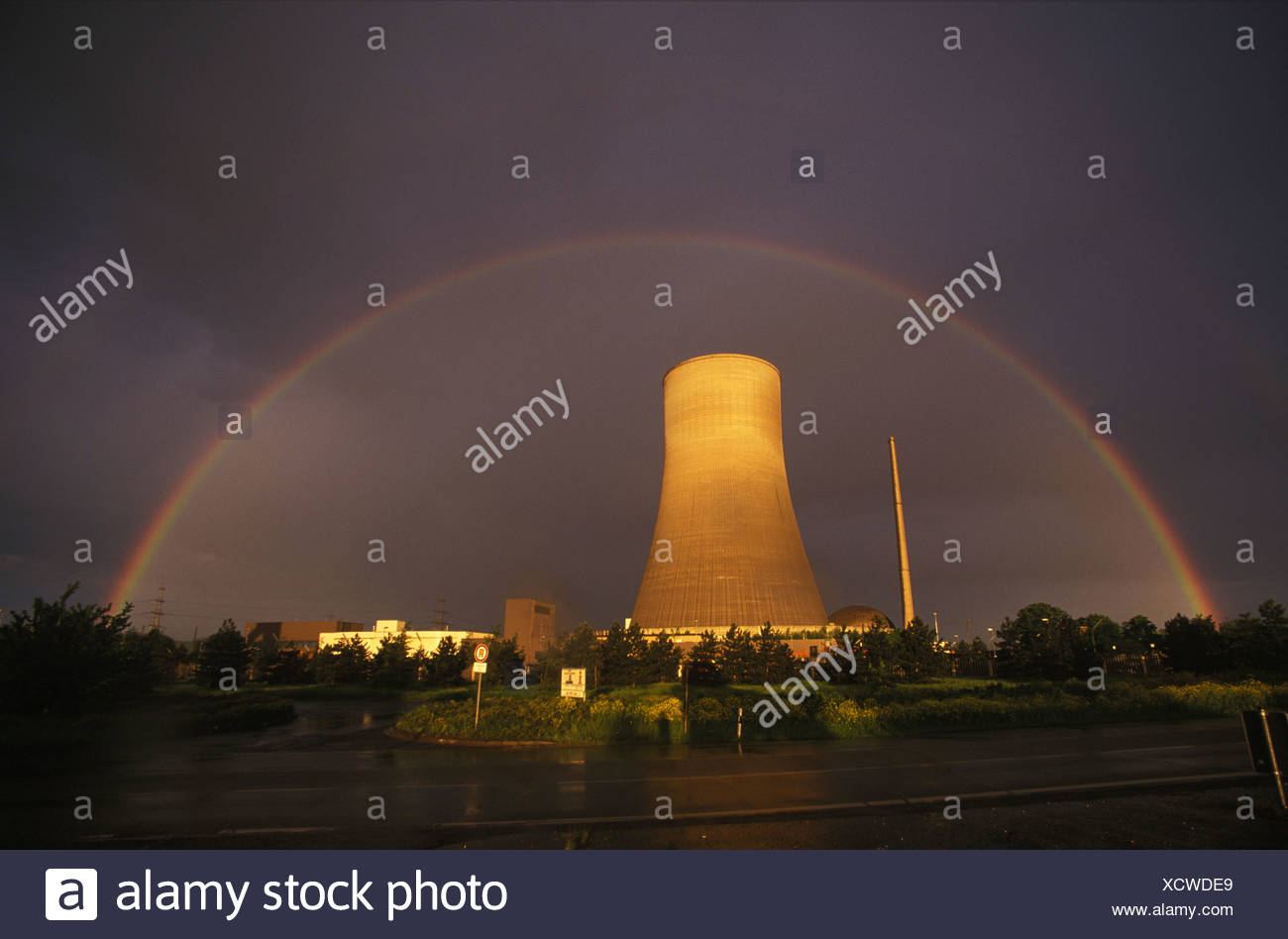Rainbow above the cooling tower of the nuclear reactor in Muelheim-Kaerlich, Rhineland-Palatinate, Germany - Stock Image