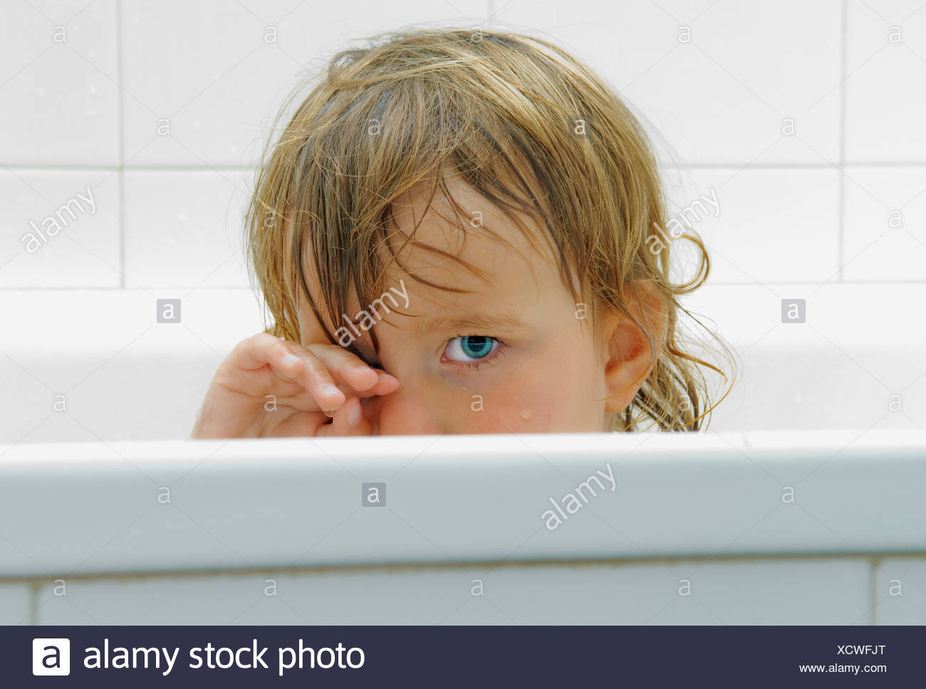 Child In Bath Tub - Stock Image