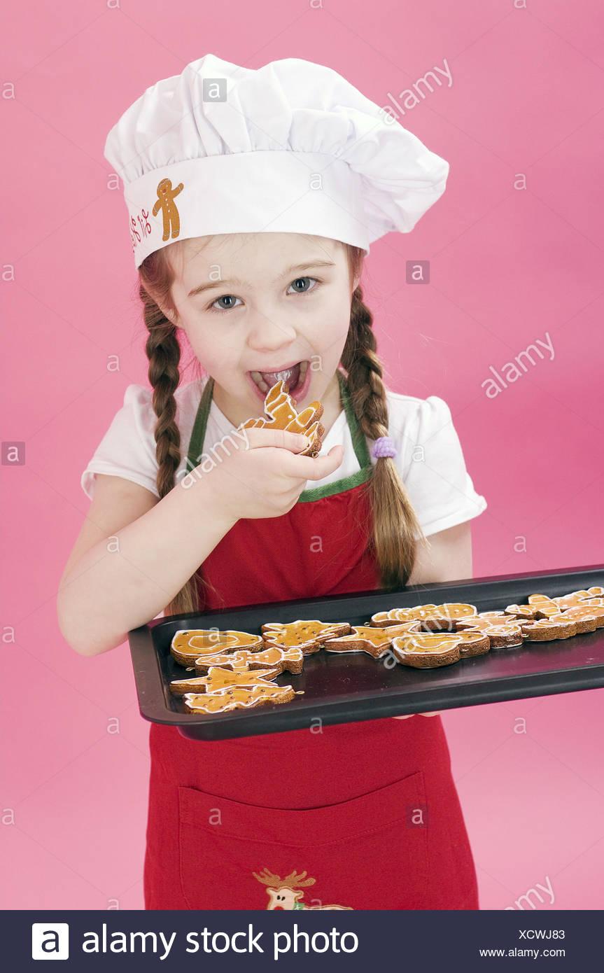 Girls, baking sheet, biscuit eat, studio, - Stock Image