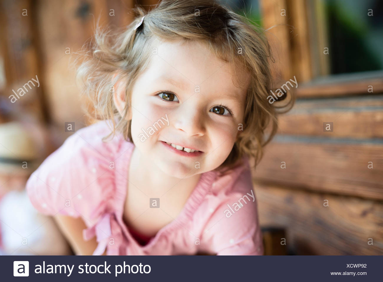 Portrait of little girl with blond hair - Stock Image