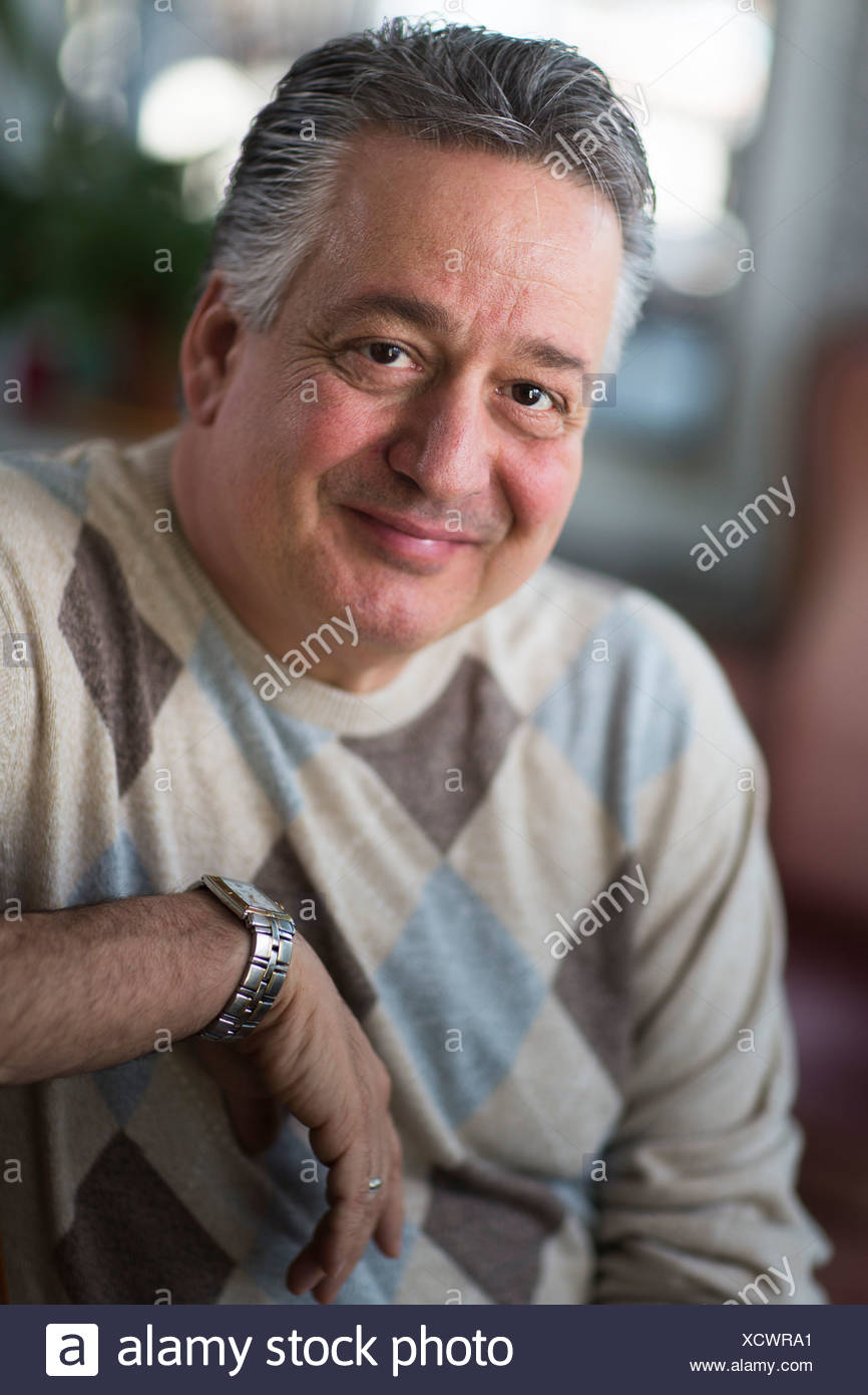 Portrait of mature man at home - Stock Image