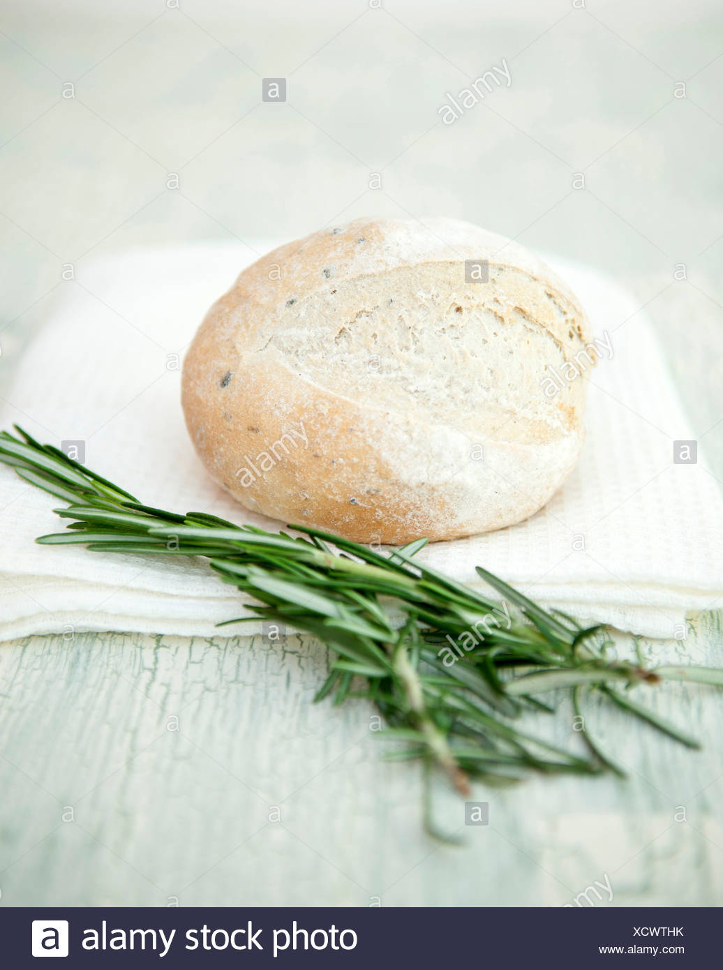 Fresh Artisan Bread with sprigs of rosemary - Stock Image