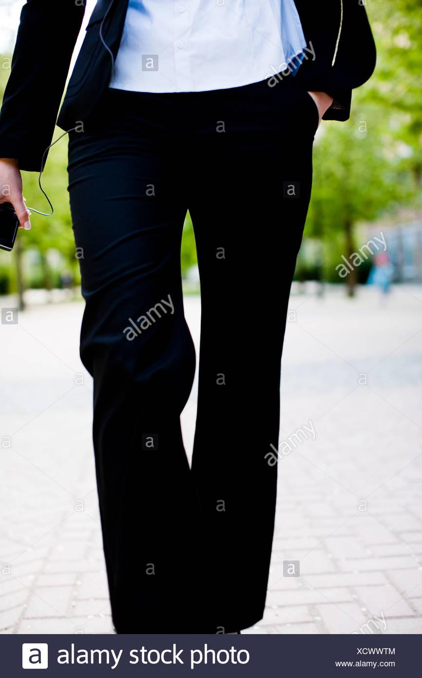 A woman walking forward, Stockholm, Sweden. - Stock Image