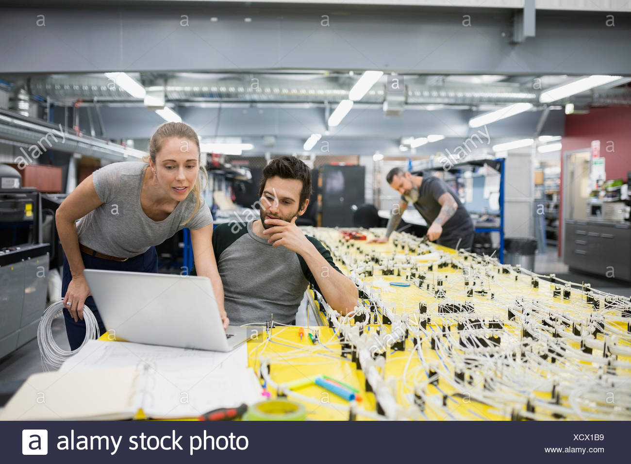 helicopter technicians using laptop at wiring harness stock photo rh alamy com