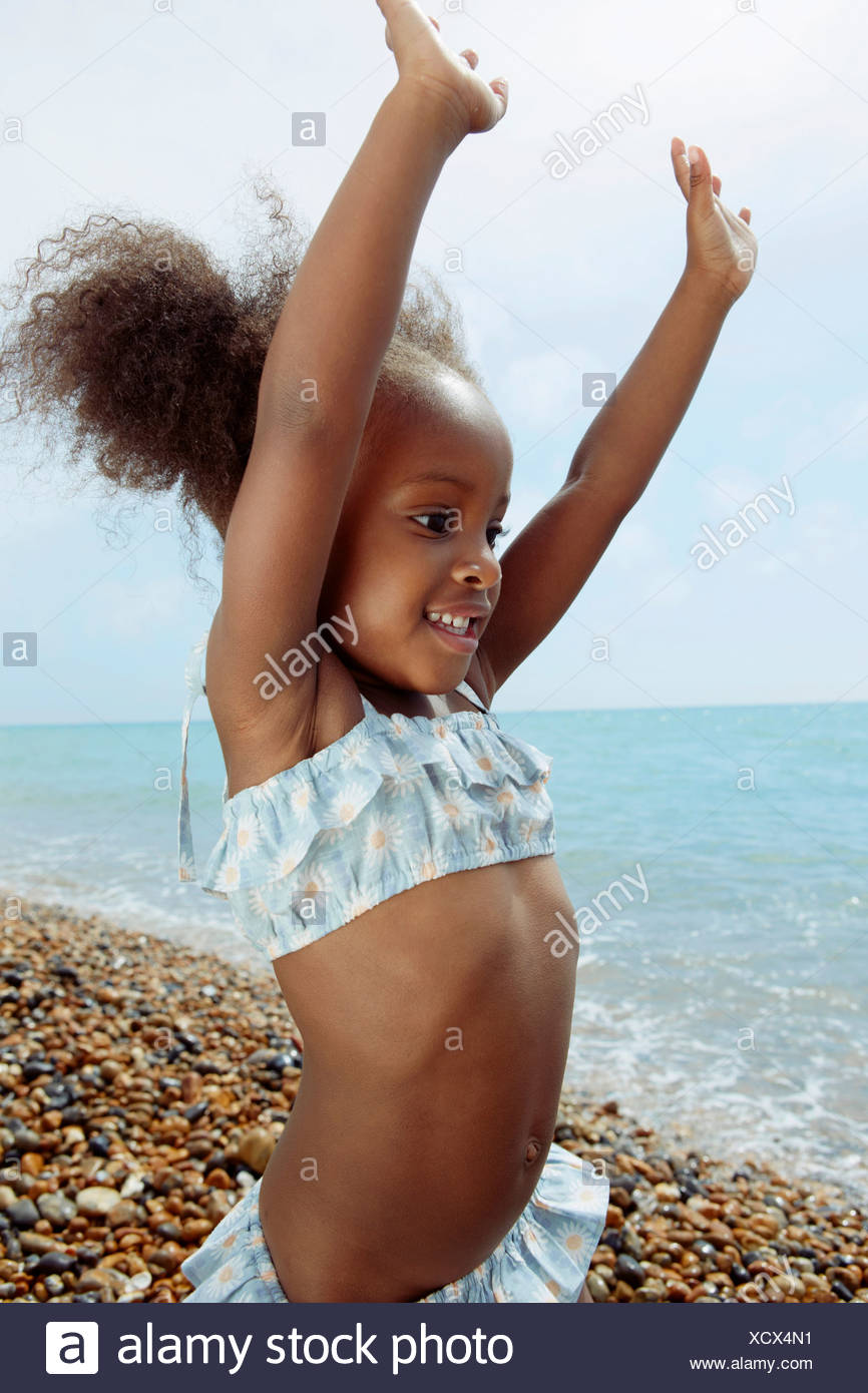Child playing on beach - Stock Image