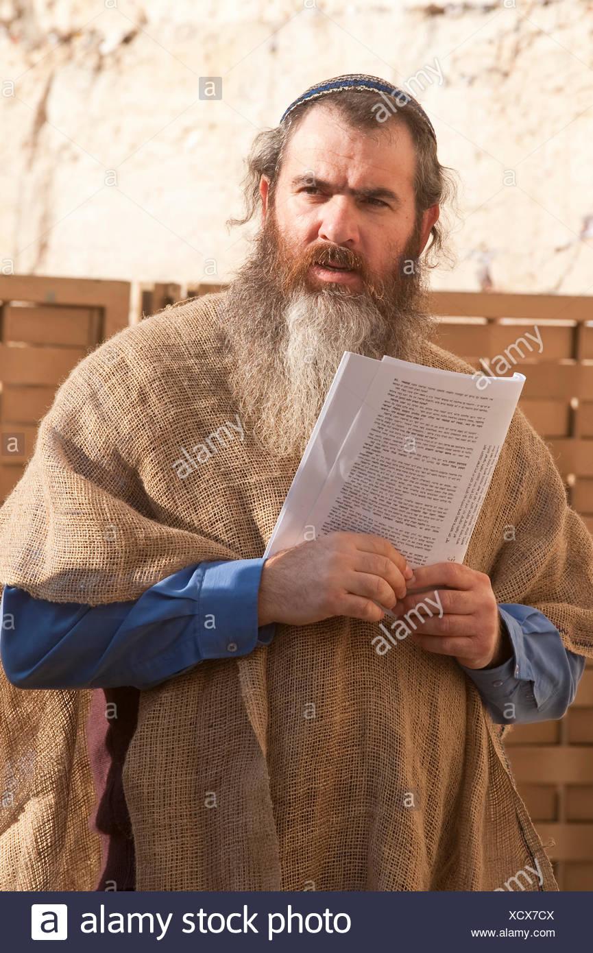 worshiper at the Western Wall, Israel, Jerusalem - Stock Image