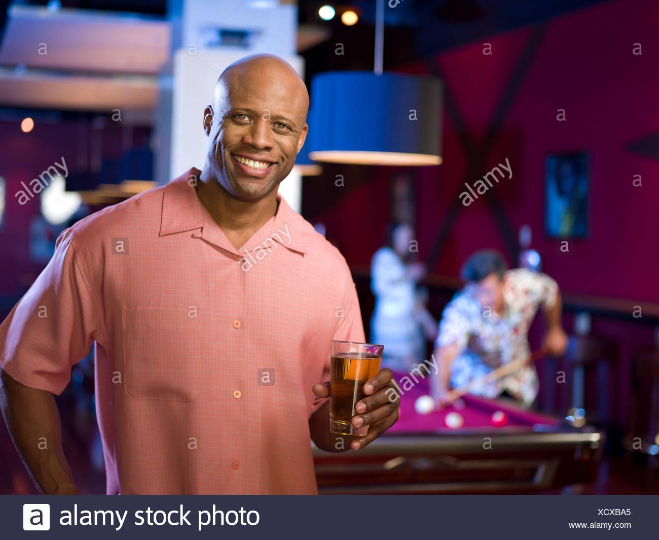 USA, Arizona, Scottsdale, Men enjoying game of pool at bar - Stock Image