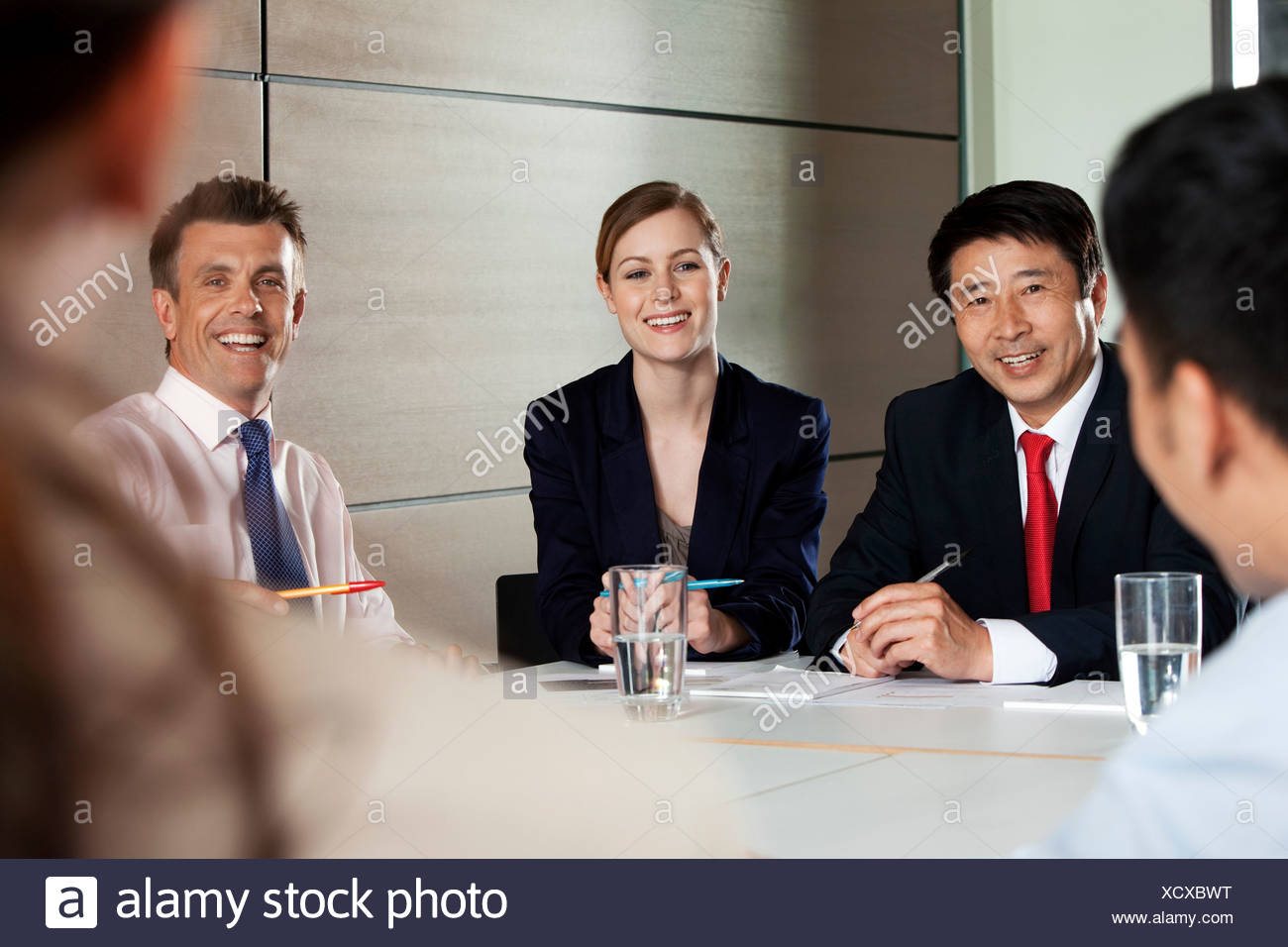 Multiracial businesspeople in meeting - Stock Image