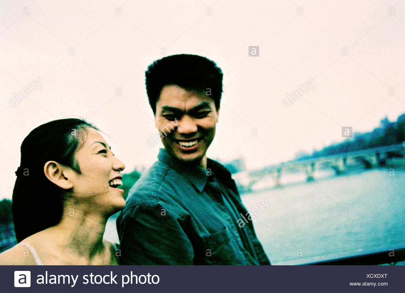 Young couple laughing. (high-grained) - Stock Image