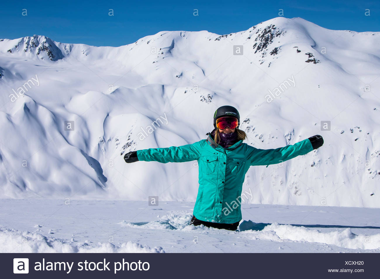 Professional Snowboarder and 2014 Olympic Gold Medalist, Jamie Anderson enjoys the mountains on a sunny bluebird day in Haines, Alaska. - Stock Image
